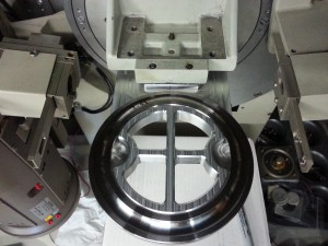 This is a completely custom stage designed to hold a large thrust bearing race such that the bottom of the groove is in the plane of diffraction for retained austenite and residual stress measurements.  The bearing is held in place by magnets.